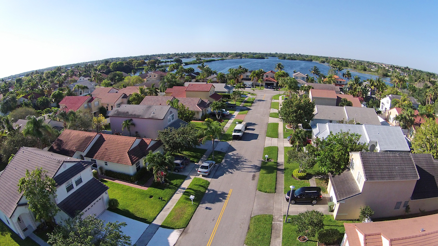 neighborhood aerial drone florida pretty houses American home loan process during COVID-19